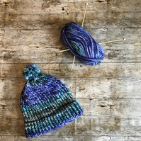 Purple and green knitted bobble hat