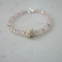 Rose quartz bracelet with a sterling silver beads and toggle clasp