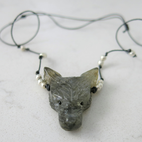 Labradorite carved wolf head pendant on corded necklace
