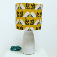 Handmade mustard linen drum lampshade featuring a Scandi bird design