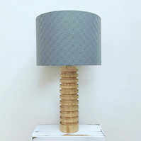 Handmade drum lampshade featuring a grey geometric square design