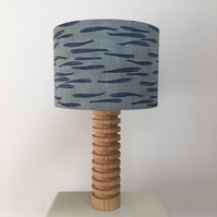 Handmade drum lampshade featuring a whale design in navy on grey
