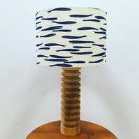 Handmade drum lampshade featuring a whale design in navy on cream