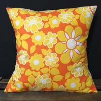 Handmade cushion featuring a retro floral print in yellow and orange