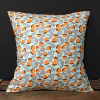 Scandi woodand inspired handmade cushion featuring squirrels and acorns,