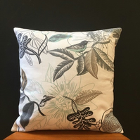 Handmade cushion featuring a bird and botanical design in grey and mint green