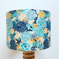 Handmade drum lampshade featuring a turquoise and mustard floral design