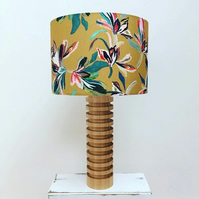Handmade mustard drum lampshade featuring a bright tropical flower design
