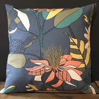 Handmade cushion featuring a bright tropical design on grey