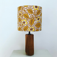 Handmade drum lampshade made using vintage mustard Sanderson fabric