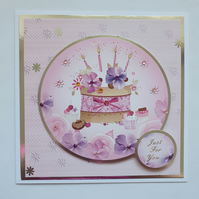 A cake and candles foil embossed birthday card