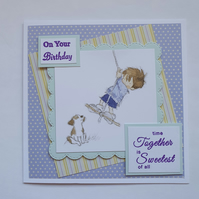 Little boy with a pet dog birthday card