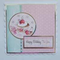 A cupcake foil embossed birthday card