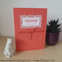 An ornate floral embossed thank you card