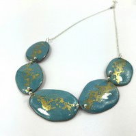 Teal and gold pebble enamel necklae