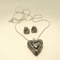 Silver and black sparkly heart shaped pendant necklace and matching earrings