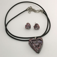 Red and black sparkly heart shaped pendant  necklace and matching red earrings.