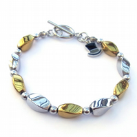 Silver and gold plated haematite bracelet