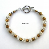 Gold plated haematite and silver tone bracelet