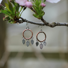 Rustic copper circle earrings with sterling silver leaves