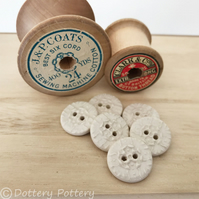 Set of six little cream coloured round ceramic handmade buttons