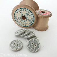 Set of six little round grey ceramic handmade buttons