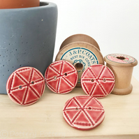 Set of four bright red ceramic handmade buttons