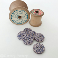 Set of six little purple coloured round ceramic handmade buttons