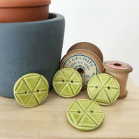 Set of four green ceramic handmade buttons