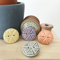 Set of four ceramic handmade buttons