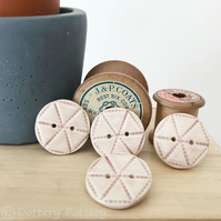 Set of four pale pink ceramic handmade buttons