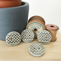 Set of four grey ceramic handmade buttons
