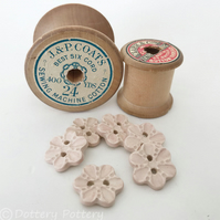 Set of six pale pink flower shaped ceramic handmade buttons