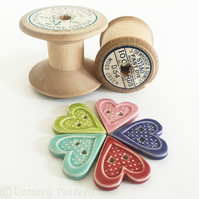 Set of five heart shaped ceramic handmade buttons