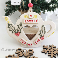 Pottery teapot decoration with a festive design