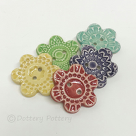 Set of five flower shaped ceramic handmade buttons