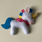 Toy felt unicorn plushie