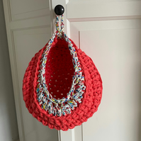 Crochet hanging basket made with upcycled tshirt yarn - coral and floral