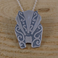 Sterlfing Silver Swirl Badger Necklace