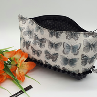 Storage bag, case in cream and grey butterfly fabric with a black bobble trim.