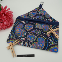 Peg bag in navy patterned fabric.