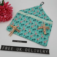 Peg bag in flamingo fabric with green lining.