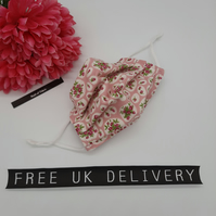 Face mask,  small, 3 layer, adjustable, washable in pink and white flowers.