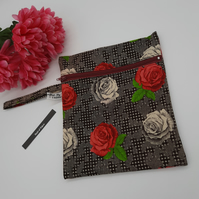 Zipped pouch,  clutch,  in red and cream rose, free uk delivery.