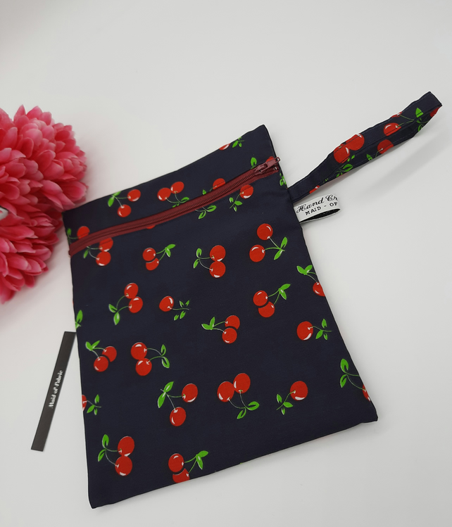 Zipped pouch,  clutch bag,  navy cherry fabric,  free uk delivery.