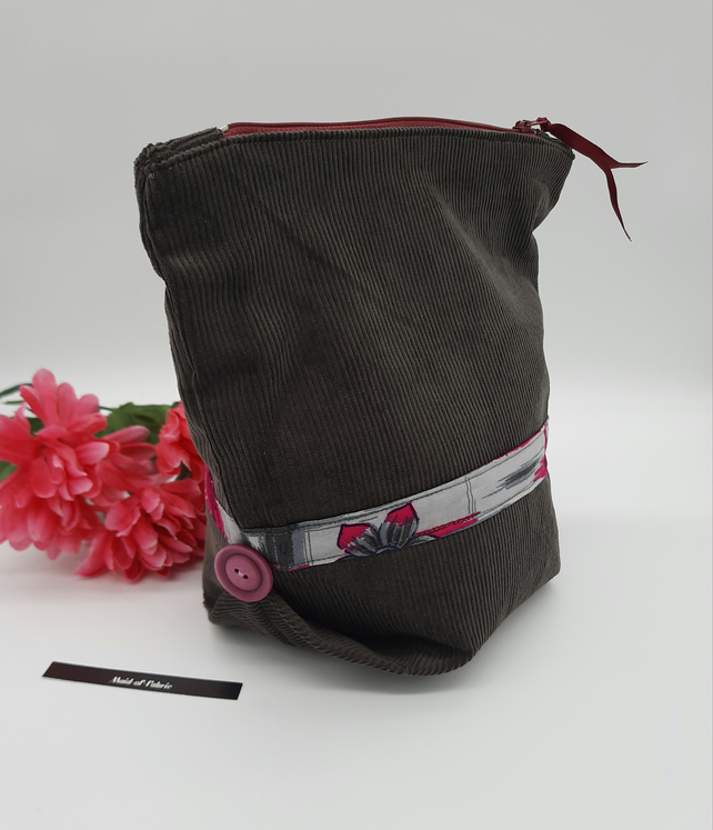 Make up bag,  grey corduroy,  pink and grey lining,  pink buttons, zipped case.