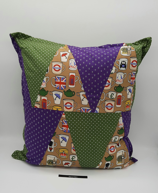 Triangle patchwork 16' cushion in London theme fabric.