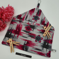 Peg bag made using pink and grey pattern cotton fabric.