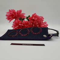 Glasses case, denim, pink circles and purple lining.