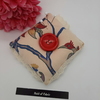Pin cushion in cream floral and bird fabric with lace